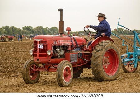 BASINGSTOKE, UK - OCTOBER 12, 2014:  Farmer John Saunders at the controls of a vintage McCormick International W4 tractor during the British National Ploughing Championships. - stock photo