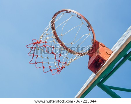 Basket and hoop outdoor with blue sky.  - stock photo