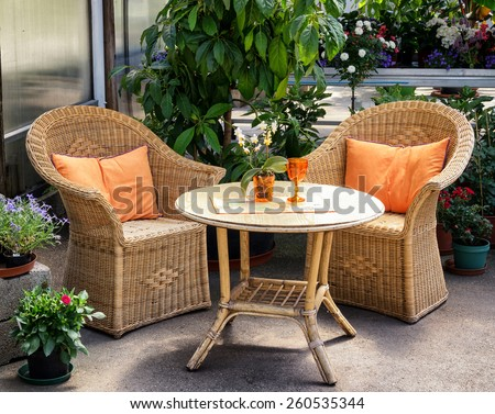 basket chairs at a patio - stock photo