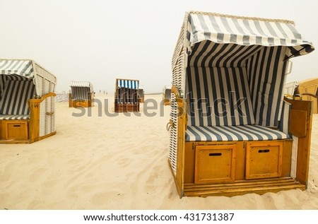 Basket Chairs on a foggy beach, Baltic sea