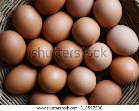 basket egg On Vintage Wooden Background  - stock photo