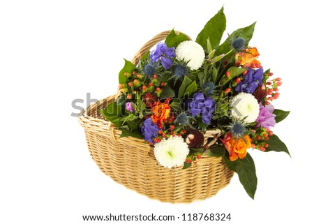 Basket filled with colorful flowers isolated over white