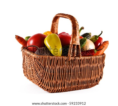 Basket filled with fresh vegetables from a kitchen garden - stock photo