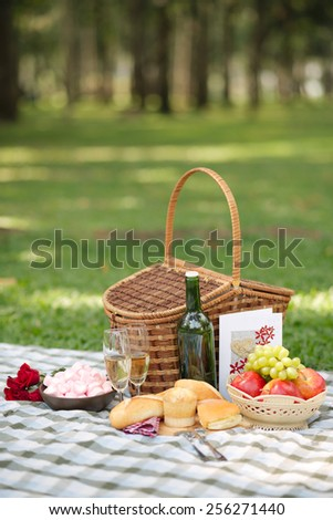 Basket, food and drinks for Valentines day picnic