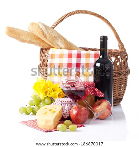 basket for picnic full with wine bread and fruit