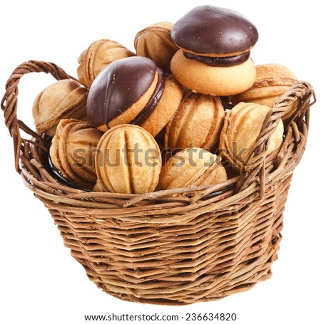 basket full christmas cookies on a white background - stock photo