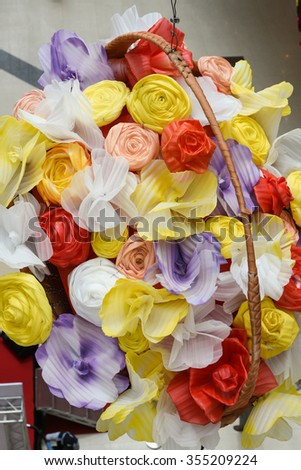 Basket full of colourful paper flowers. Wedding flower basket.Decoration bouquets of dried flowers.DRIED FLORAL BOUQUET IN A BASKET. Happy Vishu, Onam, Birthday, Wishes  - stock photo