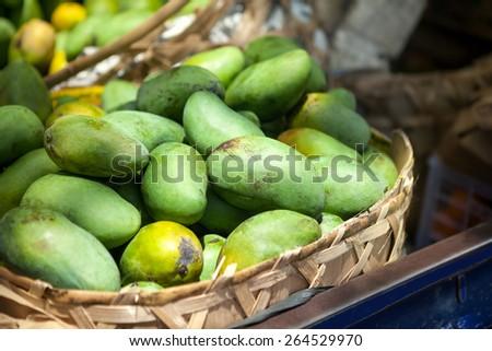 Basket full of fresh green papaya - stock photo