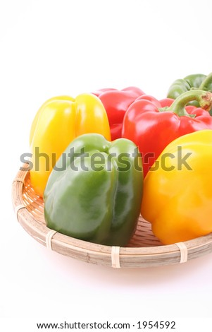 basket full of fresh peppers isolated on white