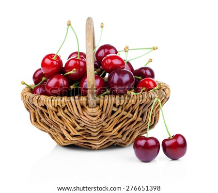 Basket full of fresh red cherry on a white background - stock photo