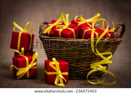 Holiday gift basket stock images royalty free images vectors basket full of red wrapped gifts negle Choice Image