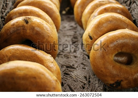 Basket full of rye bagels with shallow dept of field - stock photo