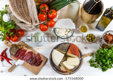 Basket full of vegetables and various fresh produce - stock photo