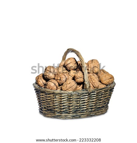 Basket full of walnuts, isolated on white