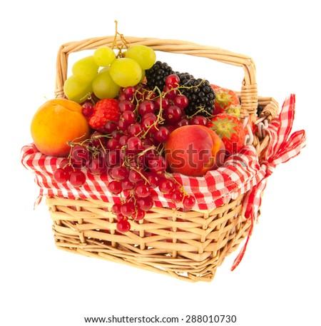 Basket full with fresh summer fruit isolated over white background - stock photo
