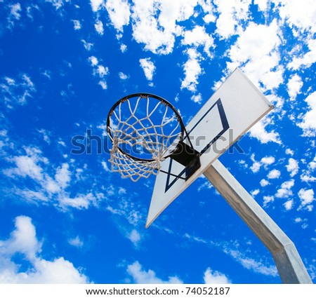 Basket hoop over a beautiful clear sky - stock photo