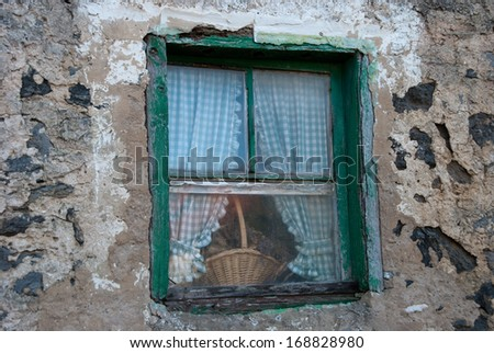 Basket in a old window in a rural house, Bask Country