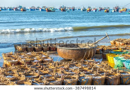Basket inside the basket boat offshore with anchovy boats at sea represents affluence filled after harvest fish and also the optimism of fishermen in livelihoods - stock photo