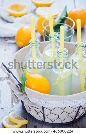 Basket lemon lemonade bottles
