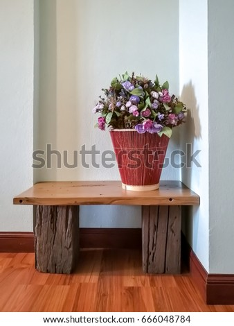Basket Of Artificial Flower Decoration On Wooden Table In Modern Rustic Living Room