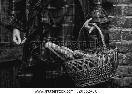 basket of bread in hands of woman, retro