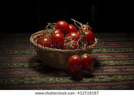 Basket of cherry tomatoes from Vesuvio under a kitchne light