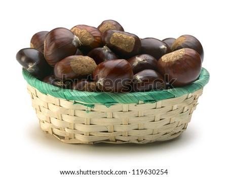basket of chestnuts on white background - stock photo