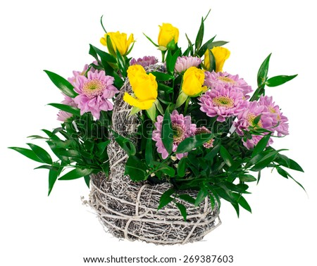 Basket of chrysanthemums and roses isolated on white