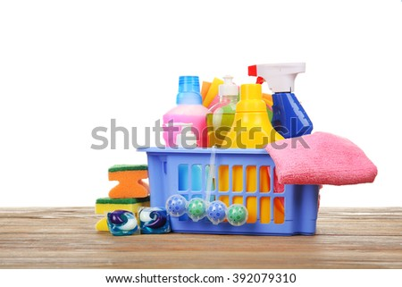Basket of cleaning supplies on the floor