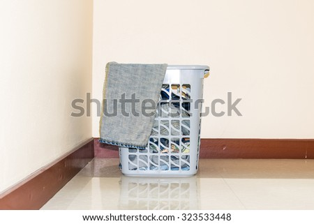 Basket of clothes to wash and prepare. - stock photo