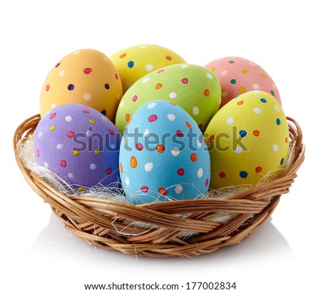 Basket of colorful Easter eggs isolated on white background - stock photo