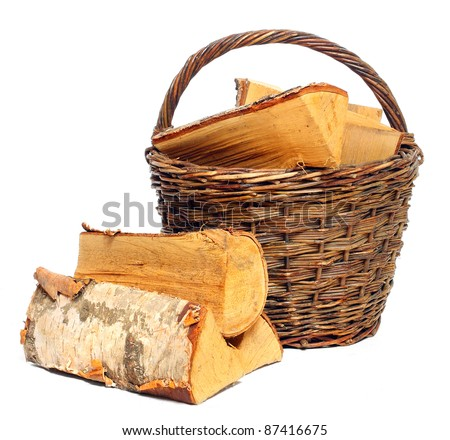 Basket of cut logs fire wood from Silver Birch tree (Betula pendula). Renewable resource of a energy. Environmental concept. - stock photo
