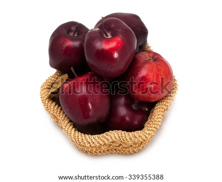 Basket of dark red apples on a white background - stock photo