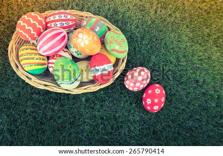 Basket of easter eggs on Fresh Green Grass ( Filtered image processed vintage effect. ) - stock photo