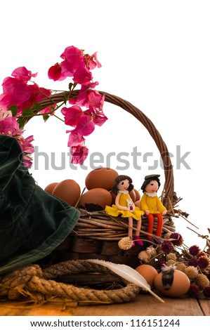 Basket of eggs on a wood table - stock photo