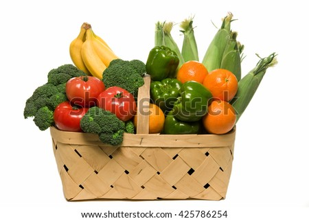 Basket of fresh raw organic vegetable produce, corn, peppers, broccoli,  tomatoes, bananas,  isolated on light background