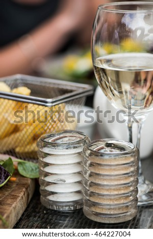 Basket of Fried Chips with a Glass of White Wine and Salt and Pepper