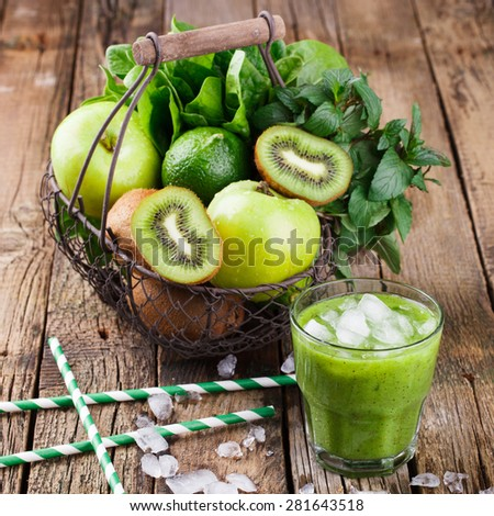 Basket of green fruit. Vitamin green set of kiwi,Apple, spinach, mint,lime.Smoothie with spinach and kiwi.selective focus - stock photo