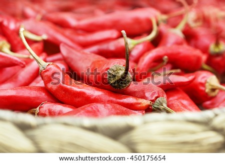 Basket of harvested  red chili peppers, selective focus, shallow DOF - stock photo