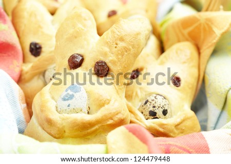 Basket of hot Easter bunny buns - stock photo
