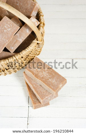 basket of marble pattern homemade soaps drying, bright wooden background