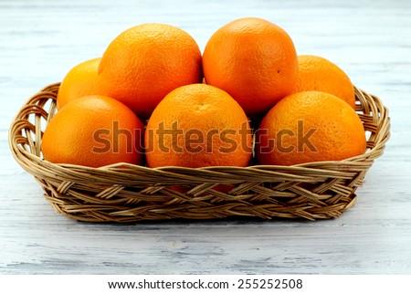 basket of oranges - stock photo