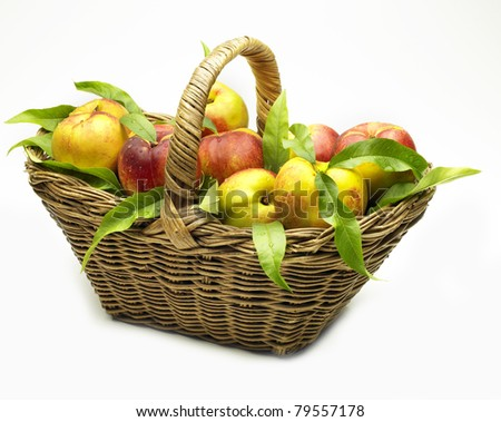 basket of peaches on white background