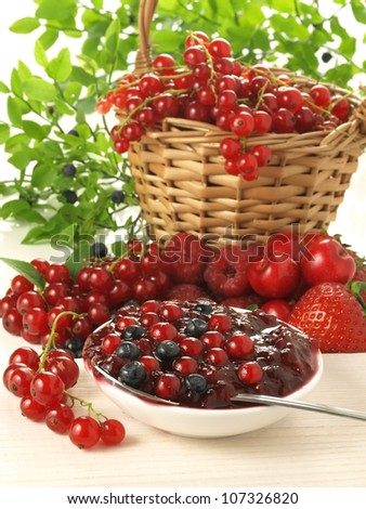 Basket of red currant, berries and cherries