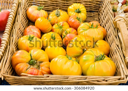 Basket of ripe heirloom tomatoes at the farm market - stock photo