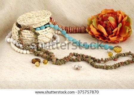 Basket of semi-precious stones on gunny background - gems for handmade - stock photo