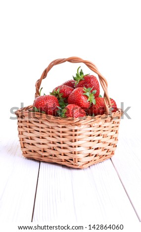 basket of strawberries isolated on white background