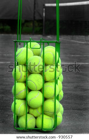 Basket of tennis balls ready for a drill - stock photo