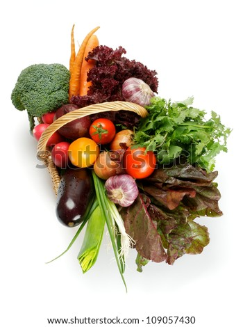 Basket of Various Vegetables with Broccoli, radishes, lettuce, onions, leeks, beets, carrots, red tomatoes, yellow tomatoes, parsley top view isolated on white background - stock photo
