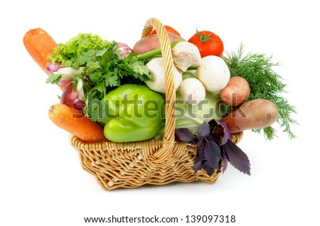 Basket of Various Vegetables with Green Bell Pepper, Carrots, Lettuce, Onions, Garlic, Parsley, Potato, Tomatoes, Cabbage, Dill, Basil and Edible Mushrooms isolated on white background - stock photo